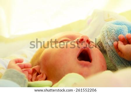 Closeup little newborn baby girl 24 days sleeping - stock photo