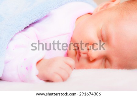 Closeup little newborn baby girl 24 days sleeping - stock photo