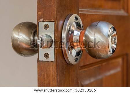 closeup locksmith and silver knob on old wood door , need to repair by professional - stock photo