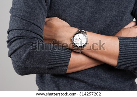 closeup luxury watch on wrist of man