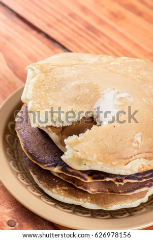 Closeup macro of american pancakes stuffed with chocolate cream on the plate.