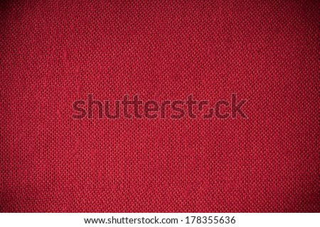Closeup macro of red fabric textile material as texture pattern background or backdrop - stock photo