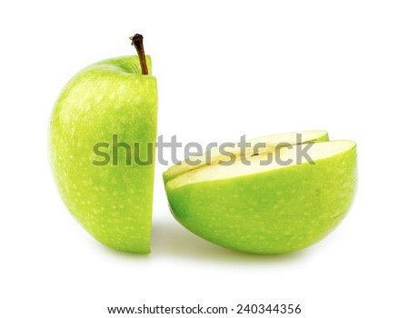 Closeup macro of two halves of a perfectly cut green apple - stock photo
