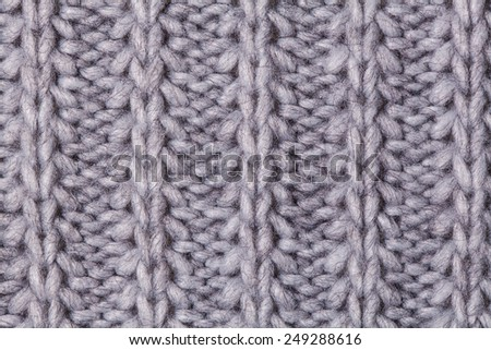 Closeup macro texture of knitted wool fabric, May use as background. - stock photo
