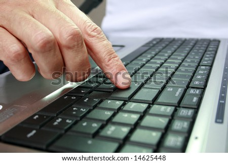 Closeup male fingers on the laptop