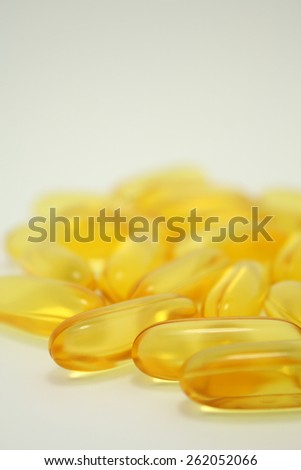 closeup many Fish Oil omega 3 soft gel capsules isolated On White Background - stock photo