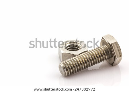Closeup metal screw and nuts on white background.  - stock photo