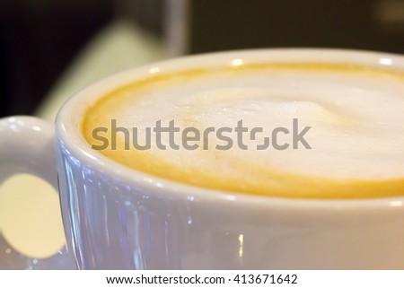 Closeup milk foam in a latte cup  - stock photo