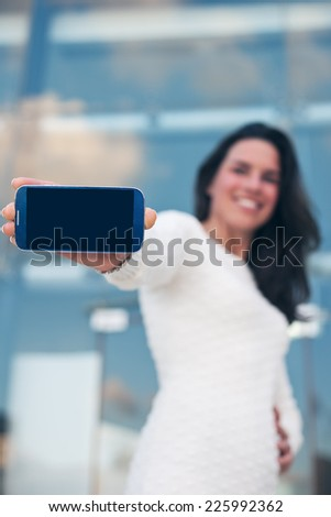 closeup mobile smartphone in hand of beautiful woman