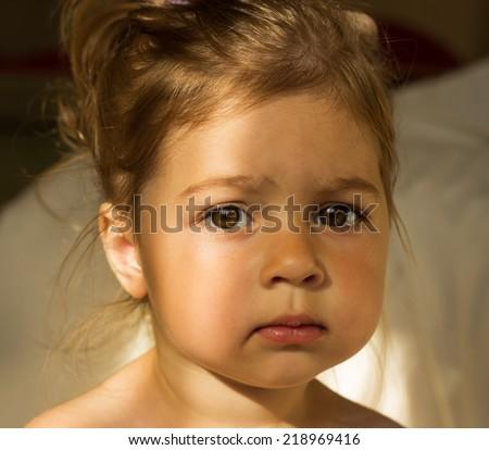 closeup morning portrait of Cute sad kid with big eyes - stock photo