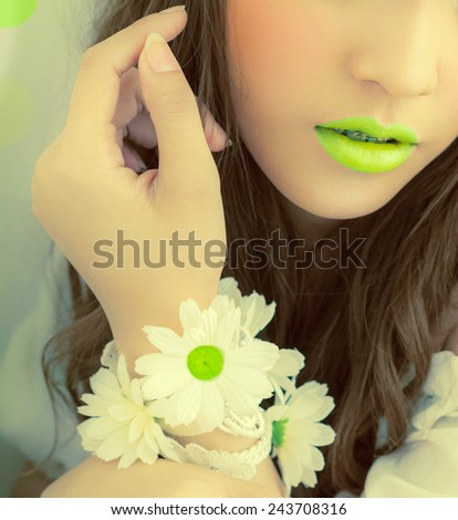 Closeup   Mouth Lime Asian fashion. Hand with flowers bokeh Professional makeup. Luxurious green bokeh .,LEMON-GREEN , young woman with flowers in their hand - stock photo