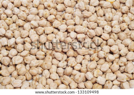 closeup of a a pile of dried chickpeas