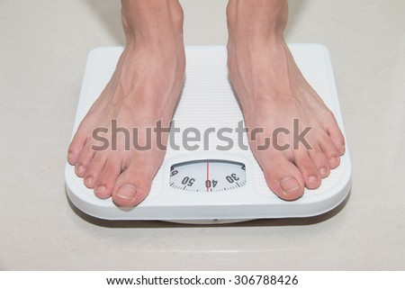Closeup of a Asians weighed