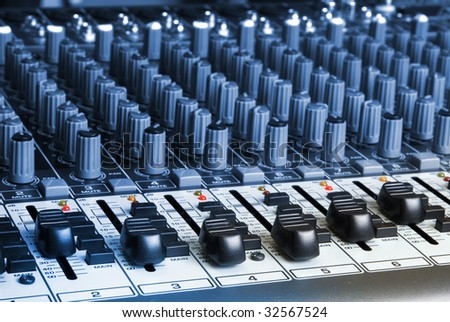 closeup of a audio mixing board