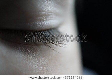 closeup of a baby's eye while he is sleeping