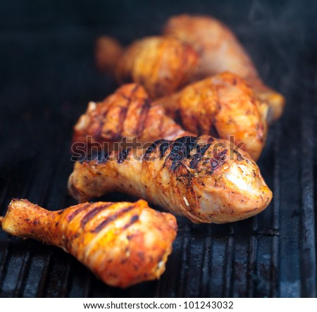 Closeup of a barbecue grill with drumstick - stock photo