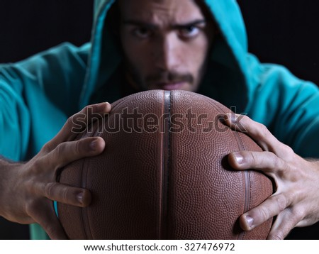 Closeup of a basketball with a rapper at the background - stock photo