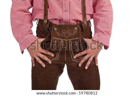 Closeup of a Bavarian man with hands in oktoberfest leather trousers (lederhose) pocket. - stock photo