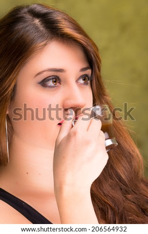 closeup of a beautiful brunette girl drinking coffee - stock photo