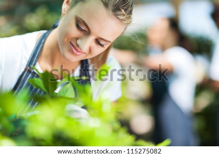closeup of a beautiful florist working in garden - stock photo