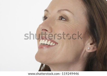 Closeup of a beautiful woman looking away on white background