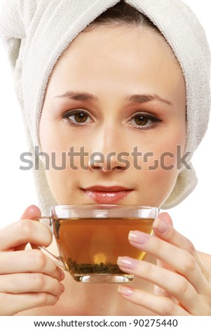 Closeup of a beautiful young woman enjoying tea  isolated on white background
