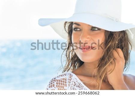 Closeup Of A Beautiful Young Woman Relaxing At Beach - stock photo