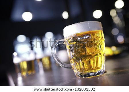 closeup of a beer mug in a bar - stock photo