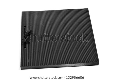 closeup of a black notebook on a white background - stock photo