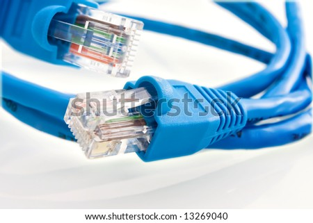 Closeup of a blue network cable with a RJ45 connector - stock photo