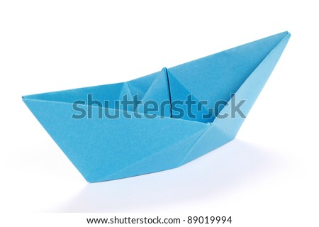 Closeup of a blue paper boat on white background