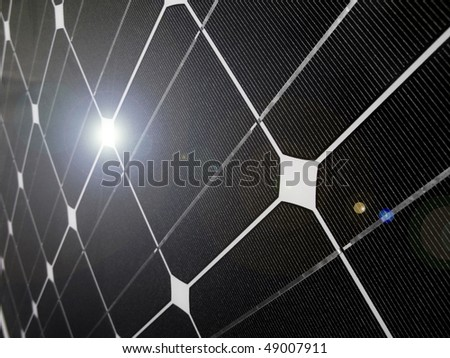 Closeup of a blue photovoltaic solar cell with sun glare - stock photo