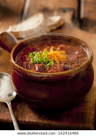 Closeup of a bowl of steaming hot chili con carne. - stock photo