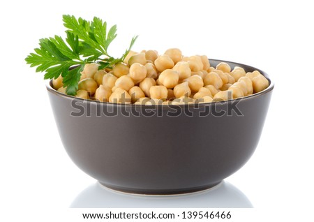 Closeup of a bowl with boiled chickpeas on a white background - stock photo