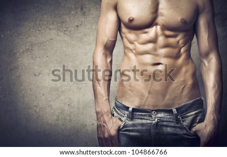 Closeup of a brawny young man's chest - stock photo