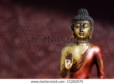 Closeup of a buddha statue in a zen pose - stock photo