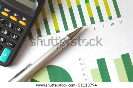 closeup of a business chart with pen and calculator - stock photo