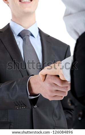 Closeup of a business handshake between two colleagues. isolated - stock photo