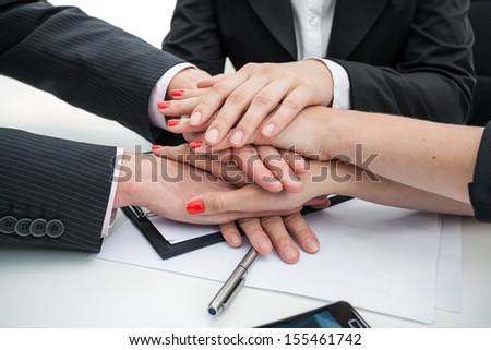 Closeup of a business people hands - team