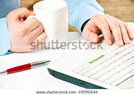 closeup of a businessman`s hands working with notebook - stock photo