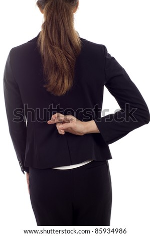 Closeup of a businesswoman with crossed fingers behind her back isolated over white background - stock photo