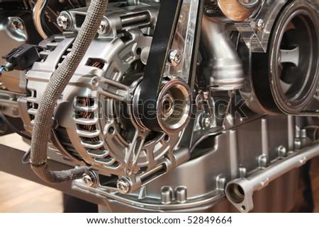 Closeup of a car alternator, component of car electrical system - stock photo