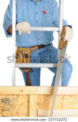 Closeup of  a carpenter climbing a ladder isolated over white. The man wearing a work shirt, jeans, gloves and a tool belt is partially hidden behind a wood framed wall. Vertical Format. - stock photo