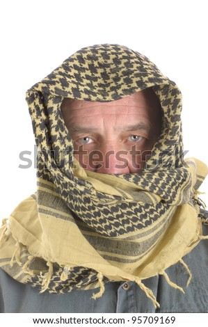 closeup of a Caucasian man with bedouin style headdress - stock photo