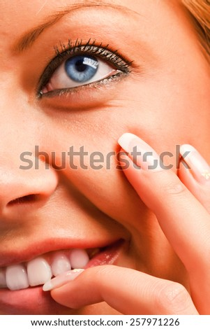 Closeup of a caucasian sensual girl's face and fingers with manicure - stock photo