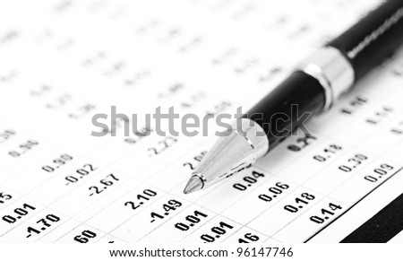 Closeup of a chart with pen - stock photo