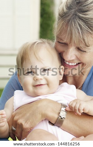 Closeup of a cheerful grandmother with granddaughter - stock photo
