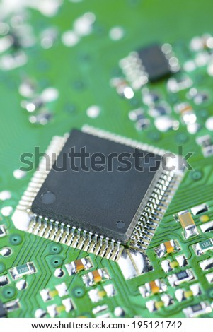 Closeup of a chip in an integrated circuit - stock photo