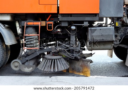 Closeup of a cleaning truck - stock photo