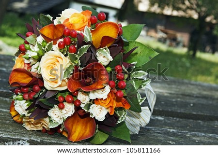 Closeup of a colorful wedding bouquet outdoors - stock photo